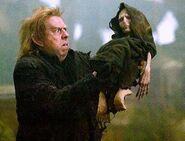 Peter Pettigrew holding Voldemort's rudimentary body