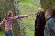 Hermione-with-wand-pointed-at-draco-600x0-c-default