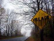 Creepy village sign