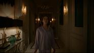 Lyra walks towards door
