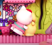 Kitty and Pompom hugging each other