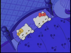 Kitty and Mimmy sleeping in bed.png