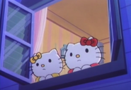 Kitty and Mimmy looking out of their window