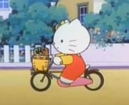 Mimmy riding her bike