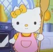 Mimmy wearing an apron