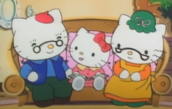 Kitty with her grandparents.PNG