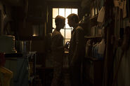 Tommy and Emily in a closet