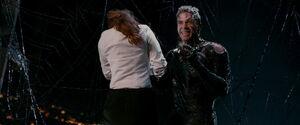 MJ being held by Venom