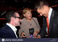 Ulrich-matthes-and-angela-merkel-and-norbert-sauer-season-opening-D5CJYE