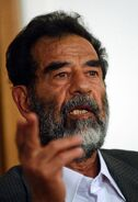800px-Saddam Hussein at trial, July 2004-edit1