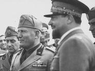 Italian-fascist-dictator-benito-mussolini-standing-beside-libyan-governor-italo-balbo a-l-7114186-4990176