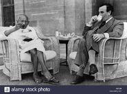 Mahatma-gandhi-eating-and-lord-mountbatten-sipping-tea-delhi-india-A2FJ2B