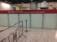Hong Kong West Kowloon remind passenger take the ticket to exit 2
