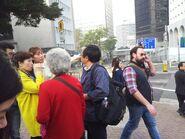 Peak Tram staff answer passengers questions in 2015