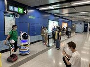 People take photo with robot 12-06-2021