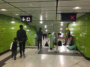 South Horizons Exit B escalator corridor