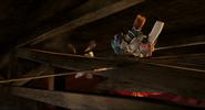 A spear hits the ceiling beam to catch Quasimodo