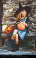 2825392-little-girl-in-witch-costume-sitting-on-bench-girl-photocase-stock-photo-large
