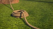 PE - A pile of rope sitting by the object the end is tied to