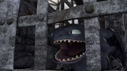 DOB - Toothless roaring inside a cage