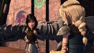 Astrid about to hand Heather her double axe