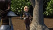 Astrid having grabbed the axe from the tree