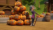 Marena standing by the pile of pumpkins