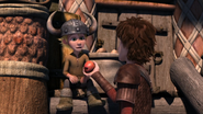 Hiccup offer an apple to a child