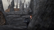 DOB - Hiccup and Toothless pop out from behind the bolder