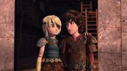 Astrid having put her arm around Hiccup