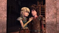 Astrid having put her right hand on Hiccup's shoulder.jpg