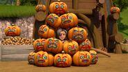 Marena in the pile of pumpkins
