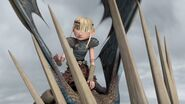 Astrid having seen the Smothering Smokebreath dragon heading for Hiccup's metal leg