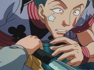Kurapika lands a blow to Hisoka