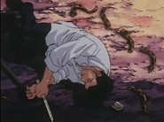 Leorio lying on the ground in pain