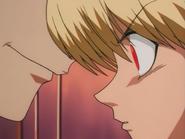 Hisoka whispering as Kurapika eyes turns red