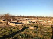 High End EF4 damage to a farmhouse near Madisonville, Kentucky