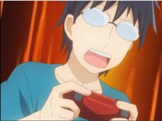 Hajime, game controller in hand.