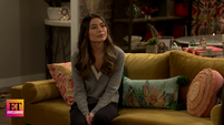 ET Carly in a gray shirt