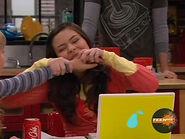 Carly bites Sam's hand