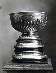 Silver trophy with bowl on top