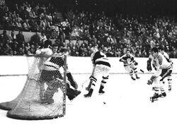 1959-60-Lumley stops Ab MacDonald.jpg