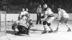 1958-59-Lumley Armstrong gold pants black socks.jpg