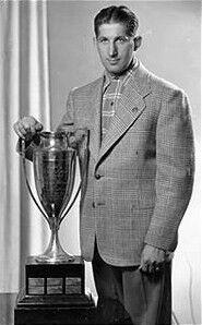 Elmer Lach with Hart Memorial Trophy.jpg