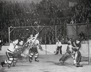 6Jan1946-Rayner clears puck, Cowley Cain