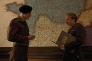 Michael Fassbender and Mike Myers with the map of France