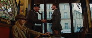 Captain Wolfgang shakes hand with Zoller