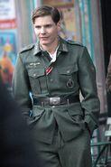 Daniel Brühl on the set dressed in uniform