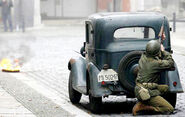 American soldier behind a car scene on the movie set