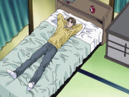 S2E11 Takumi lays on his bed